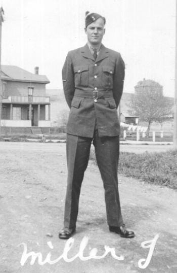 Jack Miller posing for black and white photo in his Air Force uniform, 1940s.