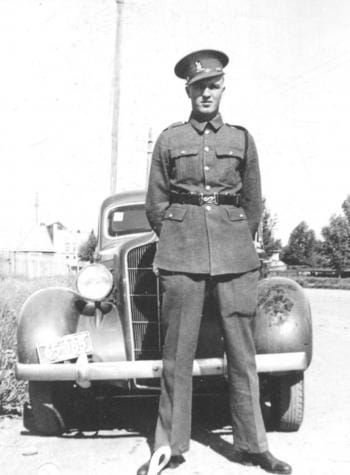 Harry Tucker posing in front of a car in the 1940s.