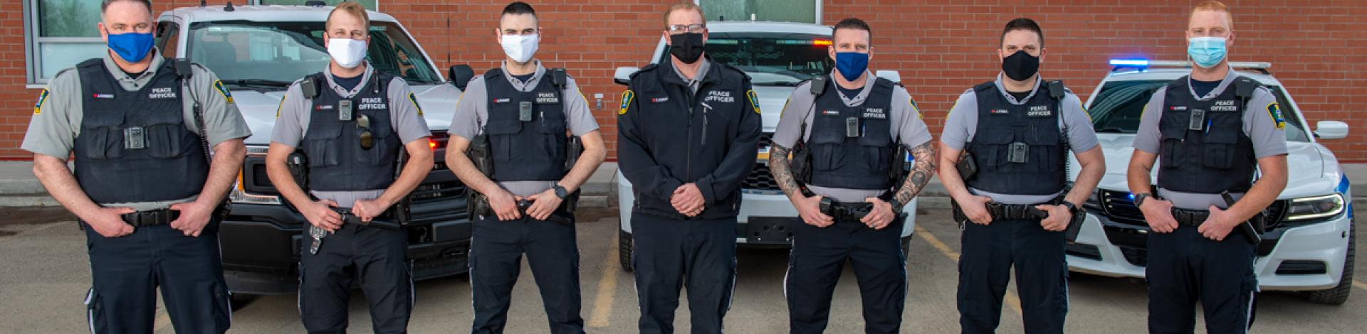 Municipal Enforcement bylaw officers standing in a row with masks on