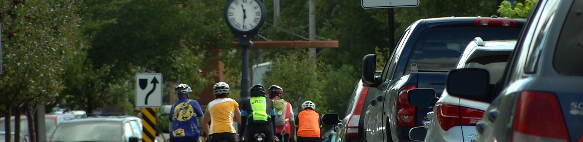 Downtown Okotoks with clock and urban cyclists