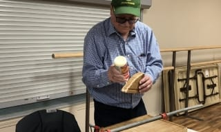 Volunteer fixing wooden cutting board at Repair Cafe