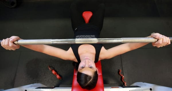 Fitness Woman Lifting Weights Bench Press