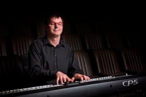 Bruce Petherick playing a keyboard