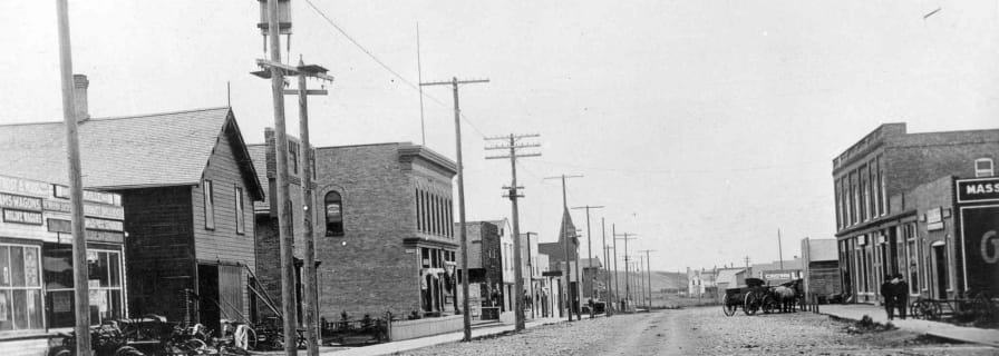 Black & white photo of main street Okotoks early 1900s