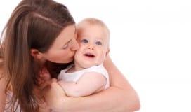 Mom kissing todller