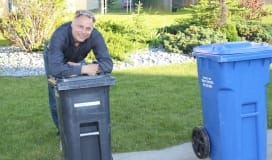 waste management, garbage cart and blue recycling cart