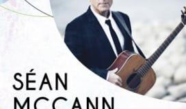 Sean McCann headshot with guitar