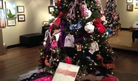 Christmas tree decorated with scarves and hats
