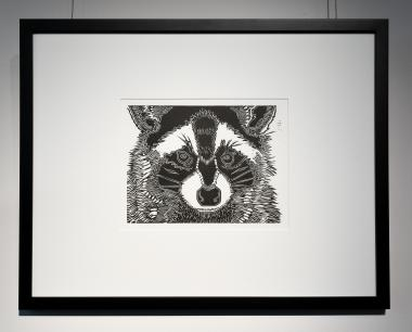 Black and white Linocut of a raccoon, by Leila Armstrong
