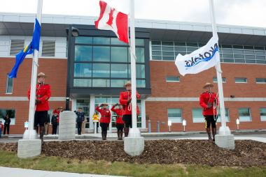 RCMP officers saluting Flags
